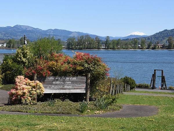 The Ruth Rose Richardson Memorial Park sign with the Columbia River and Mount St. Helens in the background.