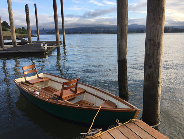 A rowboat docked along the shores of the Columbia River.