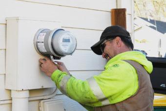 Serviceman Chuck Long installs a GenerLink transfer switch.