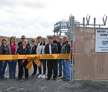 Senator Betsy Johnson and CRPUD Board Members and employees prepare to cut the ribbon at the Betsy Johnson Substation dedication.