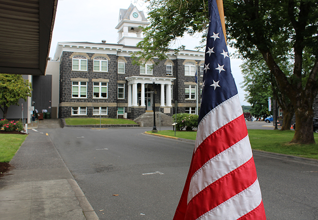 An American flag in front of the Columbia County Courthouse.