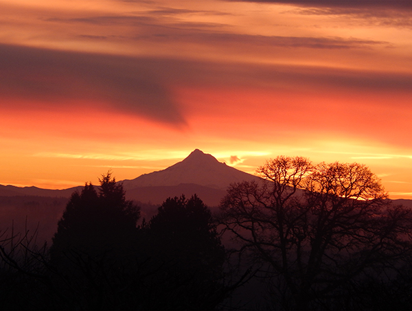Mount Hood in front of a red sunrise.