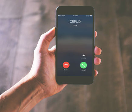 A hand holds a phone indicating that CRPUD is calling.