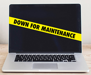"A laptop has a ribbon across it reading ""Down for Maintenance."""