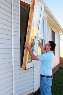 Man replacing windows.
